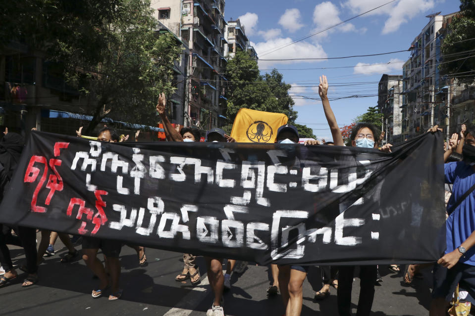 """Anti-coup protesters from various township hold slogans that reads """"Yangon boycott rally to clear all threats here in Yangon"""" during a demonstration in Yangon, Myanmar on Tuesday May 11, 2021. The military takeover of Myanmar early in the morning of Feb. 1 reversed the country's slow climb toward democracy after five decades of army rule. But Myanmar's citizens were not shy about demanding their democracy be restored. (AP Photo)"""