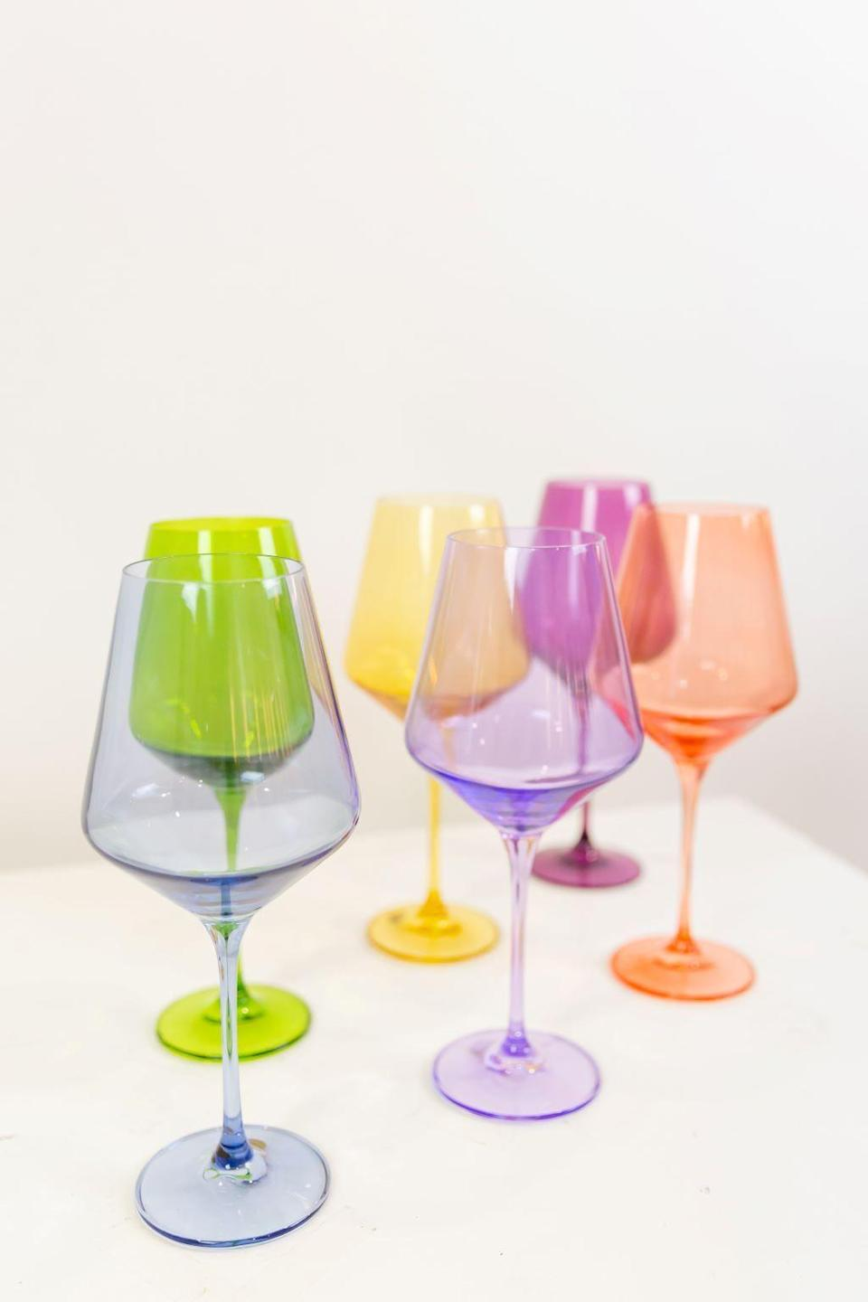 "<p><strong>Estelle</strong></p><p>estellecoloredglass.com</p><p><strong>$175.00</strong></p><p><a href=""https://www.estellecoloredglass.com/collections/glassware/products/estelle-colored-wine-stemware-mixed-set"" rel=""nofollow noopener"" target=""_blank"" data-ylk=""slk:SHOP IT"" class=""link rapid-noclick-resp"">SHOP IT</a></p><p>Make drinking wine twice as fun and lively with this set of six glasses featuring a variety of vibrant colors. They are hand blown by glass artisans in Poland (fancy) and will instantly brighten up your bar cart or kitchen cupboards. </p>"
