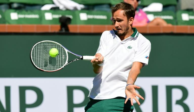 US Open champ Daniil Medvedev of Russia hits a forehand return to Grigor Dimitrov of Bulgaria in their match at the Indian Wells tennis tournament (AFP/Frederic J. BROWN)