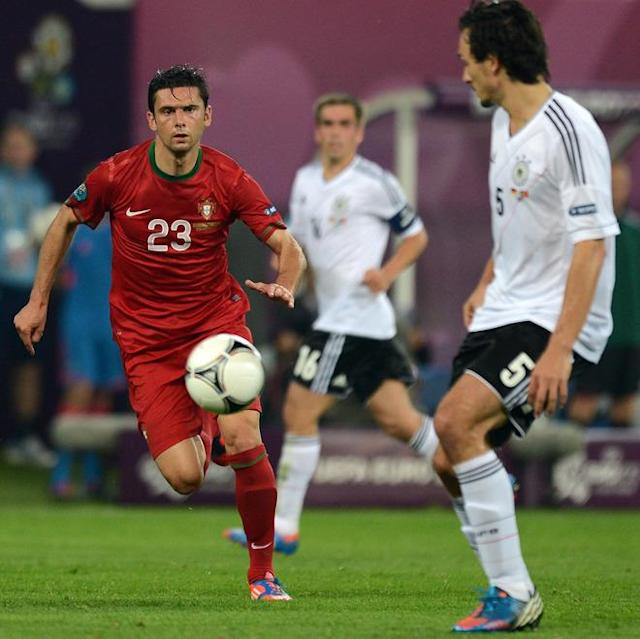 German defender Mats Hummels (R) vies with Portuguese forward Helder Postiga during the Euro 2012 championships football match Germany vs Portugal on June 9, 2012 at the Arena Lviv. AFP PHOTO / JEFF PACHOUDJEFF PACHOUD/AFP/GettyImages