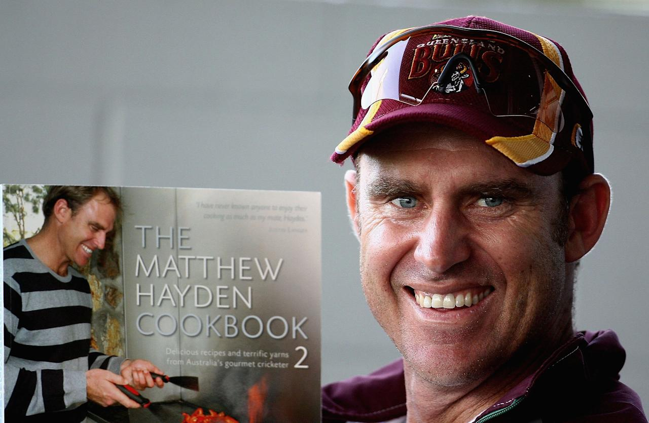 PERTH, AUSTRALIA - NOVEMBER 17:  Matthew Hayden of the Bulls displays his cookbook from the players pavillion during the Ford Ranger Cup match between the Western Australian Warriors and the Queensland Bulls at the WACA on November 17, 2006 in Perth, Australia.  (Photo by Paul Kane/Getty Images)