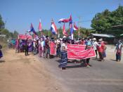 Protesters hold placards during the ant-coup protest in Hpapun Township