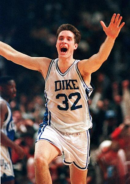 "FILE - In this March 28, 1992, file photo, Duke's Christian Laettner runs down the court after making the last-second winning shot to defeat Kentucky 104-103 in overtime in the East Regional Final NCAA college basketball game in Philadelphia. For the first time since Laettner's improbable buzzer-beater, head coaches Mike Krzyzewski and Rick Pitino are meeting in the regional finals of the NCAA tournament. Pitino is across the state in Louisville these days, but that doesn't lessen the drama of their long-awaited ""rematch."" (AP Photo/Amy Sancetta, File)"