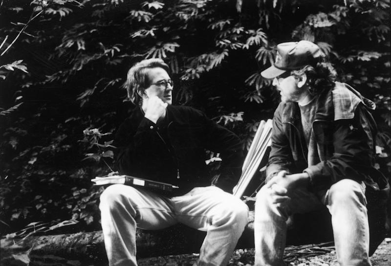 American director Steven Spielberg speaks with assistant director David Koepp (left) on the set of Spielberg's film, 'The Lost World: Jurassic Park,' 1997. (Photo by Universal Studios/Getty Images)