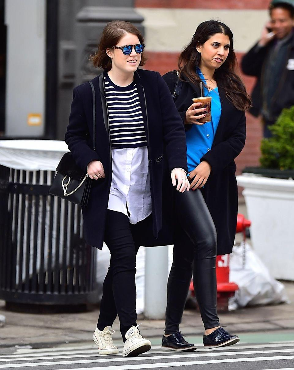 <p>Princess Eugenie wandered the streets of Soho, New York with a friend. The royal wore a trendy cropped top over an oversized white button-down. </p>