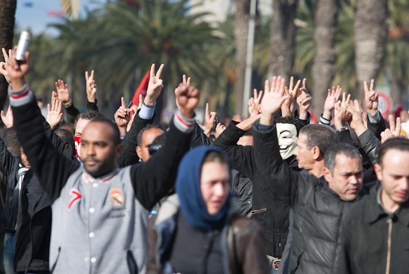 Demonstrators raise their hands to protest the killing of opposition leader Chokri Belaid in Tunis, Wednesday, Feb. 6, 2013. The Tunisian opposition leader critical of the Islamist-led government and violence by radical Muslims was shot to death Wednesday, the first political assassination in post-revolutionary Tunisia. The killing is likely to heighten tensions in the North African nation whose path from dictatorship to democracy so far has been seen as a model for the Arab world. (AP Photo/Amine Landoulsi)