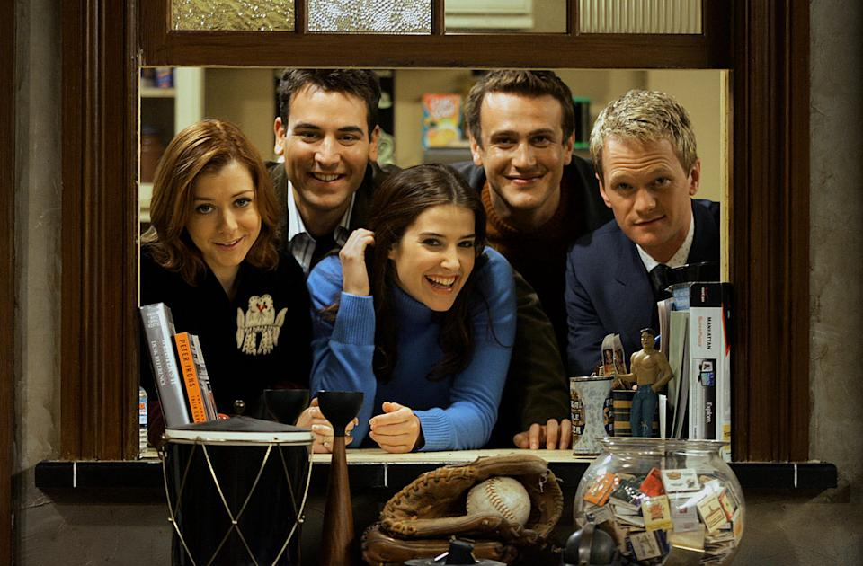 Cobie Smulders, center, surrounded by her 'How I Met Your Mother' cast mates in 2005. (Photo: Getty Images)
