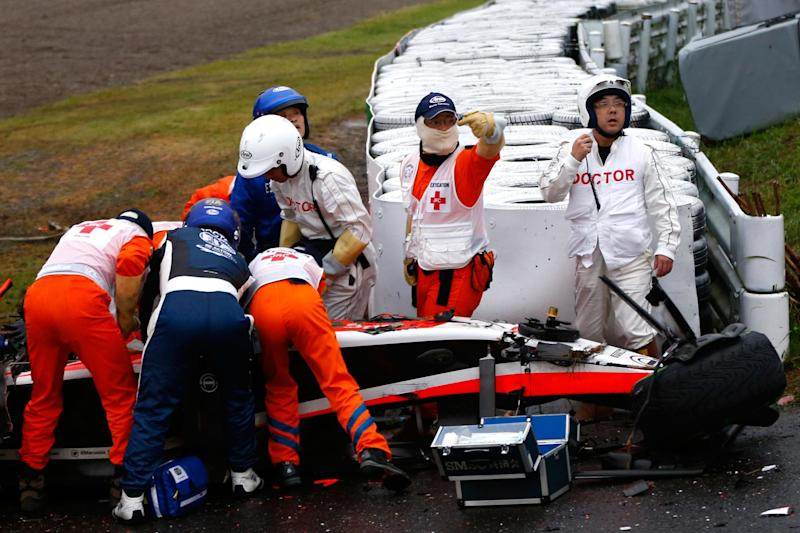 Bianchi receives medical treatment after crashing during the Japanese Formula One Grand Prix in 2014Getty