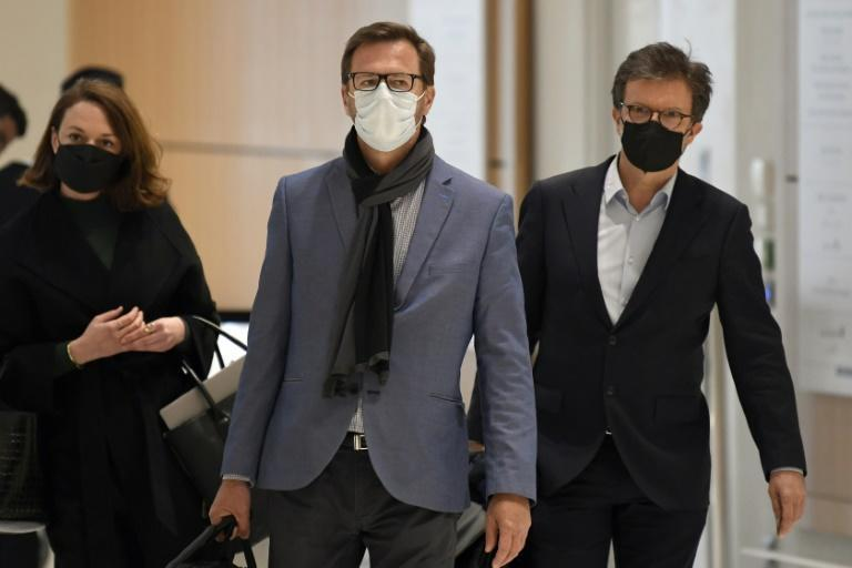 Jerome Lavrilleux (centre), Sarkozy's former deputy campaign manager, arriving at court