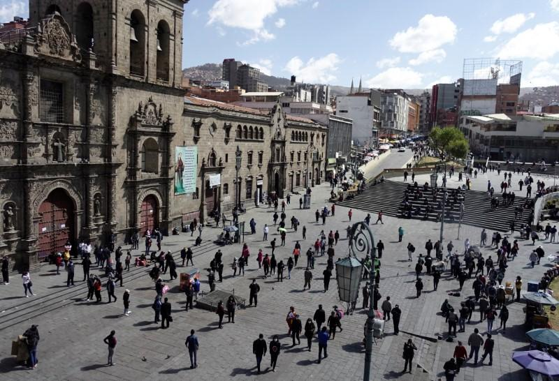 People walk at the Plaza San Francisco on the first day of eased coronavirus disease (COVID-19) restrictions in La Paz