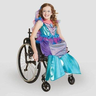 """<p><strong>Hyde & EEK! Boutique</strong></p><p>target.com</p><p><strong>$30.00</strong></p><p><a href=""""https://www.target.com/p/kids-adaptive-mermaid-costume-dress-with-headpiece-hyde-eek-boutique/-/A-79804318"""" rel=""""nofollow noopener"""" target=""""_blank"""" data-ylk=""""slk:Shop Now"""" class=""""link rapid-noclick-resp"""">Shop Now</a></p><p>Kids can become denizens of the deep with this mermaid dress, which comes with the coordinating headpiece. The rest is a one-piece dress with an opening at the back. You can also get a <a href=""""https://www.target.com/p/kids-39-adaptive-mermaid-halloween-costume-wheelchair-cover-with-hairpiece-hyde-38-eek-boutique-8482/-/A-79283792"""" rel=""""nofollow noopener"""" target=""""_blank"""" data-ylk=""""slk:shell wheelchair cover"""" class=""""link rapid-noclick-resp"""">shell wheelchair cover</a> separately.</p>"""