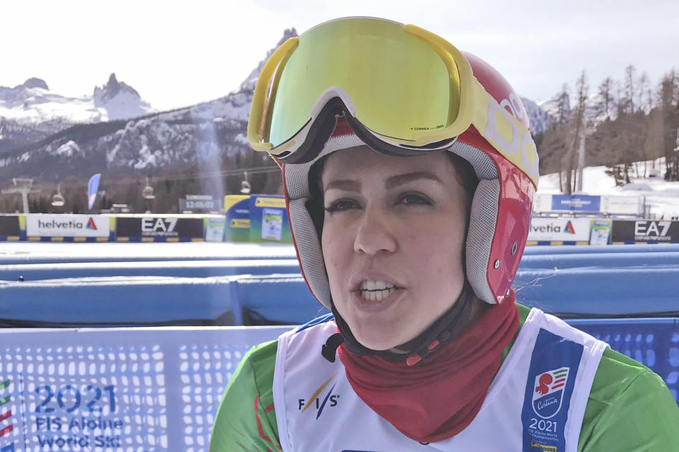 Iran's Forough Abbasi is interviewed in the finish area after the first run of a women's giant slalom, at the alpine ski World Championships, in Cortina d'Ampezzo, Italy, Thursday, Feb. 18, 2021. (AP Photo/Andrew Dampf)