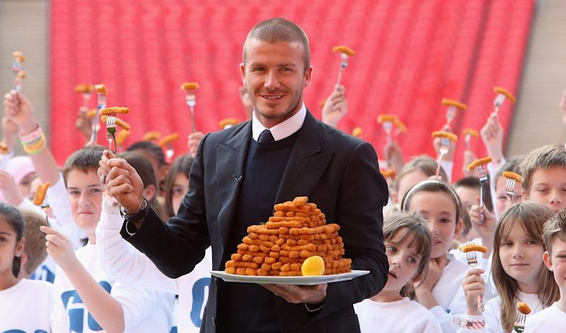 LONDON - OCTOBER 16: Footballer David Beckham poses with children as he launches the new GO3 food range at Wembley Stadium on October 16, 2008 in London, England. (Photo by Chris Jackson/Getty Images)