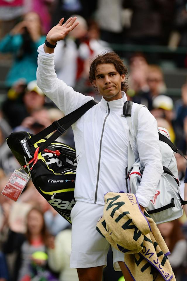 LONDON, ENGLAND - JUNE 24: Rafael Nadal of Spain waves to the crowd as he leaves Court One following his defeat to Steve Darcis of Belgium after Gentlemen's Singles first round match on day one of the Wimbledon Lawn Tennis Championships at the All England Lawn Tennis and Croquet Club on June 24, 2013 in London, England. (Photo by Mike Hewitt/Getty Images)