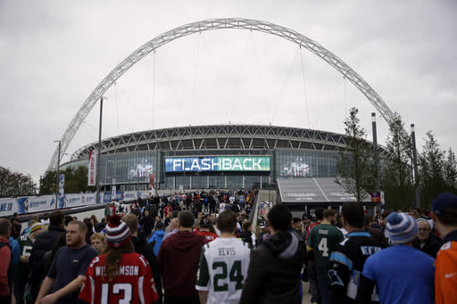 FILE - In this Oct. 26, 2014, file photo, sans arrive at Wembley Stadium before an NFL football game between the Atlanta Falcons and the Detroit Lions in London. The NFL is moving its five games scheduled for London and Mexico City this season back to U.S. stadiums because of the coronavirus pandemic, two people with knowledge of the switch told The Associated Press. All five regular-season games will be played at the stadiums of the host teams, the people said, speaking to the AP on condition of anonymity Monday, May 4, 2020, because the decision has not been announced publicly. (AP Photo/Matt Dunham, File)
