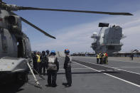 Military personnel on board the aircraft carrier HMS Queen Elizabeth as it participates in the NATO Steadfast Defender 2021 exercise off the coast of Portugal, Thursday, May 27, 2021. NATO has helped provide security in Afghanistan for almost two decades but the government and armed forces in the conflict-torn country are strong enough to stand on their own feet without international troops to back them, the head of the military organization said Thursday. (AP Photo/Ana Brigida)