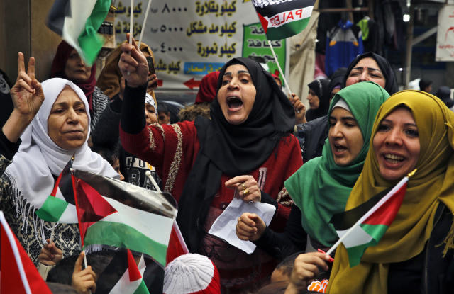 <p>Palestinian women chant slogans as they hold Palestinian flags during a sit-in in the Bourj al-Barajneh Palestinian refugee camp, in Beirut, Lebanon, Wednesday, Dec. 6, 2017. (Photo: Bilal Hussein/AP) </p>