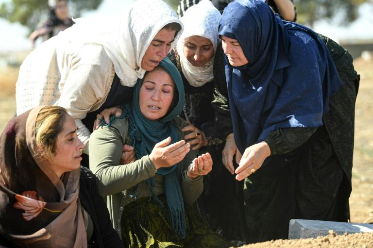 There has been a mounting civilian death toll on both sides of the border as Turkish troops and their Syrian allies exchange fire with Kurdish forces (AFP Photo/Ozan KOSE)