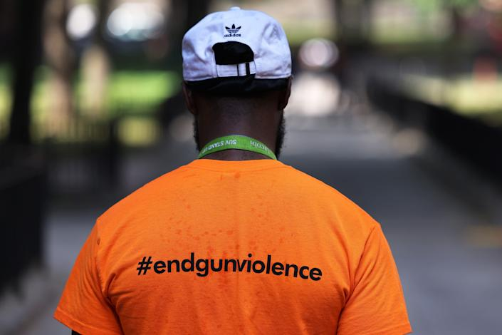 Khayan Reed, an outreach worker with Stand Up to Violence, walks as he and members of Stand Up to Violence canvass and hand out ice cream at the Bronx River Houses on June 30, 2021, in the Soundview neighborhood of Bronx borough in New York City.