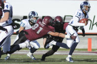 San Diego quarterback Keith Williams (19) scrambles from the outstretched arms of Montana defensive end Tyrone Holmes (91) during the first half of an NCAA college football game, Saturday, Nov. 29, 2014, in Missoula, Mont. (AP Photo/Lido Vizzutti)