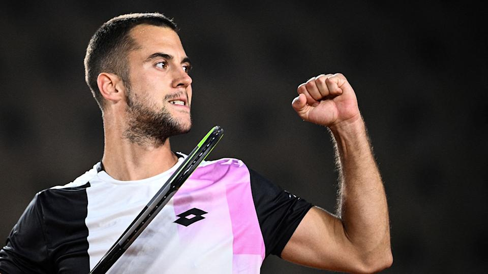 Pictured here, Laslo Djere celebrates his French Open win against Corentin Moutet.
