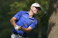 Brian Harman hits from the 12th tee during the first round of the BMW Championship golf tournament, Thursday, Aug. 27, 2020, at Olympia Fields Country Club in Olympia Fields, Ill. (AP Photo/Charles Rex Arbogast)