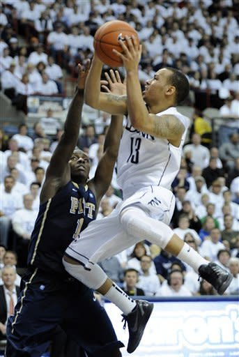 Connecticut's Shabazz Napier, right, drives past Pittsburgh's Tray Woodall during the second half of Connecticut's 74-65 victory in an NCAA college basketball game in Storrs, Conn., on Saturday, March 3, 2012. (AP Photo/Fred Beckham)