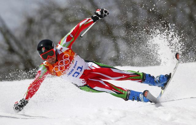 Portugal's Arthur Hanse crashes during the first run of the men's alpine skiing giant slalom event at the 2014 Sochi Winter Olympics at the Rosa Khutor Alpine Center February 19, 2014. REUTERS/Dominic Ebenbichler (RUSSIA - Tags: SPORT SKIING OLYMPICS TPX IMAGES OF THE DAY)