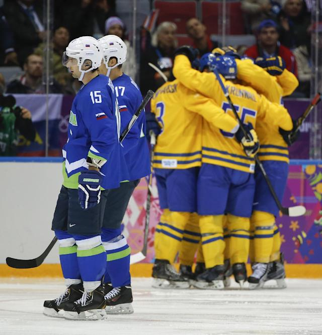 Slovenia defenseman Blaz Gregorc and defenseman Ziga Pavlin skate back to the bench after a goal by Sweden in the third period of a men's ice hockey game at the 2014 Winter Olympics, Wednesday, Feb. 19, 2014, in Sochi, Russia. (AP Photo/Julio Cortez)