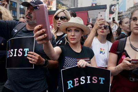 FILE PHOTO: Actress Alyssa Milano attends a protest in Times Square, New York City