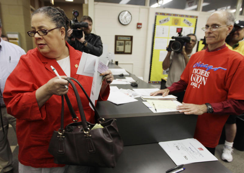 In this June 6, 2012 photo, Chicago Teachers Union President Karen Lewis casts her ballot during a strike authorization vote at a Chicago high school. Angered by Mayor Rahm Emanuel's call for a longer school day and wage and benefit concessions, 25,000 Chicago teachers voted this week to consider authorizing their first strike in a quarter-century. (AP Photo/M. Spencer Green)