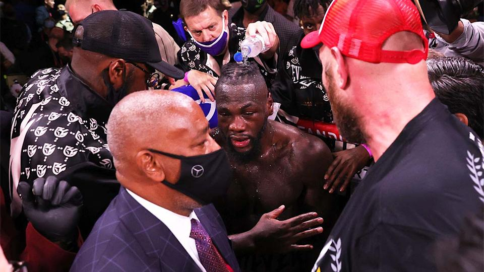Deontay Wilder (pictured middle) refusing to talk to Tyson Fury (pictured right) after their fight.