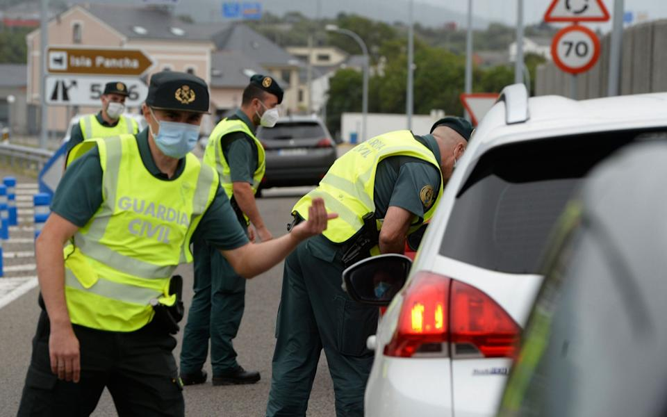 Spanish Civil Guards control a checkpoint on the highway between the regions of Galicia and Asturias in Ribadeo, after the region ordered the lockdown of 70,000 people - AFP