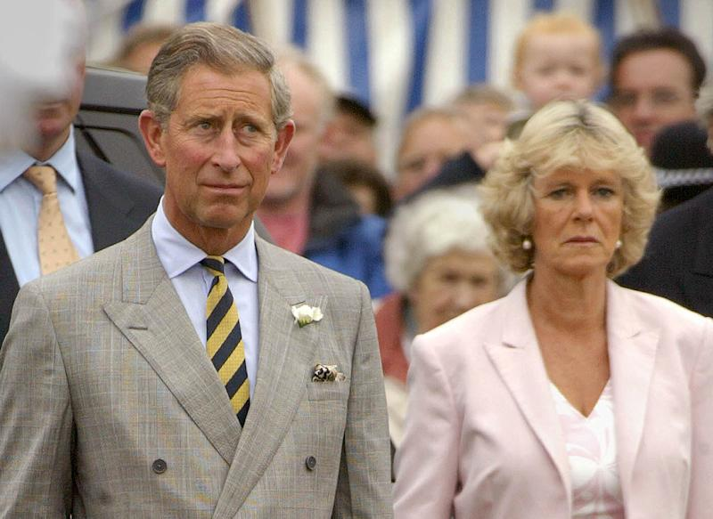 SANDRINGHAM, ENGLAND - JULY 31: Prince Charles and Camilla Parker Bowles stand for the British National Anthem as they arrive for the Sandringham Flower Show on the Royal Sandringham Estate July 31, 2002 in Norfolk, England. Camilla arrived with Prince Charles, suggesting an effort on the part of the British Royal Family to introduce her to more public Royal duties due to her relationship with the Prince. (Photo by Sion Touhig/Getty Images)