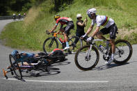 France's Julian Alaphillippe, right, avoid crashing into Spain's Peio Bilbao, center, and Spain's Ion Izaguirre Insausti, left, during the fourteenth stage of the Tour de France cycling race over 183.7 kilometers (114.1 miles) with start in Carcassonne and finish in Quillan, France, Saturday, July 10, 2021. (AP Photo/Christophe Ena)