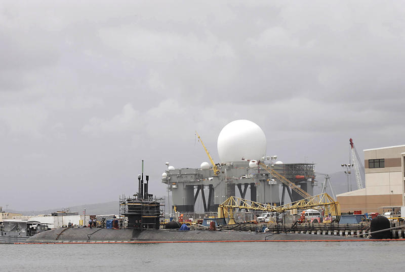 FILE - The USS Honolulu, a Navy submarine, is seen at dock with the Sea-Based X-Band Radar platform in the rear, at Pearl Harbor in Honolulu in this March 10, 2006 file photo. With the Pacific Command and the Navy, Air Force, Army and Marine Corps all with their own headquarters for the Pacific on Oahu, the island is a prime location for high-stakes, international sleuthing. (AP Photo/Marco Garcia)