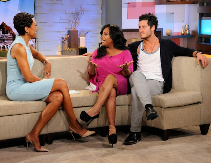 """In this April 11, 2012 photo released by ABC, host Robin Roberts, left, speaks with TV personality Sherri Shepherd and her dance partner Val Chmerkovskiy after they were eliminated from the celebrity dance competition series """"Dancing with the Stars,"""" during an appearance on the morning show """"Good Morning America"""" in New York. The Nielsen Co. said Monday that ABC's """"Good Morning America"""" beat NBC's morning show last week by a razor-thin margin of 13,000 viewers. (AP Photo/ABC, Donna Svennevik)"""