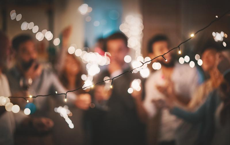 If you're looking to change up your holiday party this year, we've got some fun ideas. (Photo: gilaxia via Getty Images)