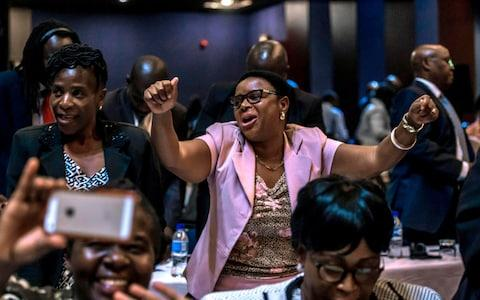 MPs danced and started singing - Credit: JEKESAI NJIKIZANA/AFP