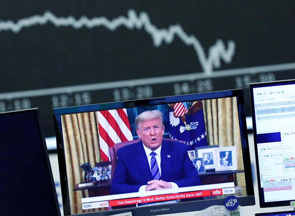 A television broadcast showing U.S. President Donald Trump is pictured during a trading session at Frankfurt's stock exchange in Frankfurt, Germany, March 12, 2020.    REUTERS/Ralph Orlowski
