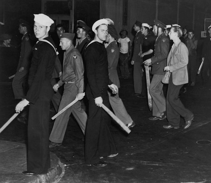 """<p>As the United States was in throes of World War II, there was trouble in Los Angeles too. The <a href=""""https://www.latimes.com/local/lanow/la-me-ln-zoot-suit-riots-anniversary-20180604-story.html"""" rel=""""nofollow noopener"""" target=""""_blank"""" data-ylk=""""slk:Zoot Suit Riots"""" class=""""link rapid-noclick-resp"""">Zoot Suit Riots</a> took place in June 1943, and involved U.S. servicemen and young Mexican-Americans.</p>"""