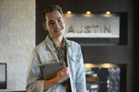 Connor Payne poses for a photo near his home, Wednesday, Jan. 13, 2021, in Austin, Texas. Payne, 23, moved to Austin in the summer of 2019 and was still getting to know the city and making new friends when the pandemic hit. He's worked for an event planning company for the last year nervously, watching as coworkers got laid off. (AP Photo/Eric Gay)