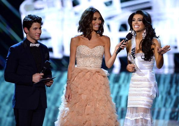 LAS VEGAS, NV - JUNE 16: (L-R) Recording artist and host Nick Jonas and television personality and host Giuliana Rancic look on as Miss Utah USA Marissa Powell answers a question from a judge during the interview portion of the 2013 Miss USA pageant at PH Live at Planet Hollywood Resort & Casino on June 16, 2013 in Las Vegas, Nevada. (Photo by Ethan Miller/Getty Images)