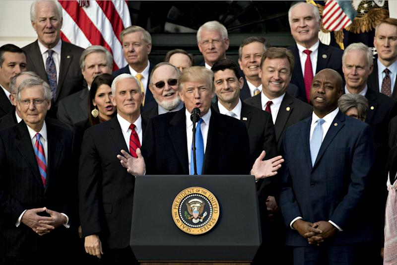 U.S. President Donald Trump, center, speaks during a tax bill passage event with Republican congressional members of the House and Senate on the South Lawn of the White House in Washington, D.C., U.S., on Wednesday, Dec. 20, 2017. (Photo: Andrew Harrer/Bloomberg via Getty Images)