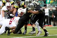 Oregon running back Thomas Tyner (24) stretches to score a touchdown during the second quarter against Stanford in an NCAA college football game in Eugene, Ore., Saturday, Nov. 1, 2014. (AP Photo/Ryan Kang)
