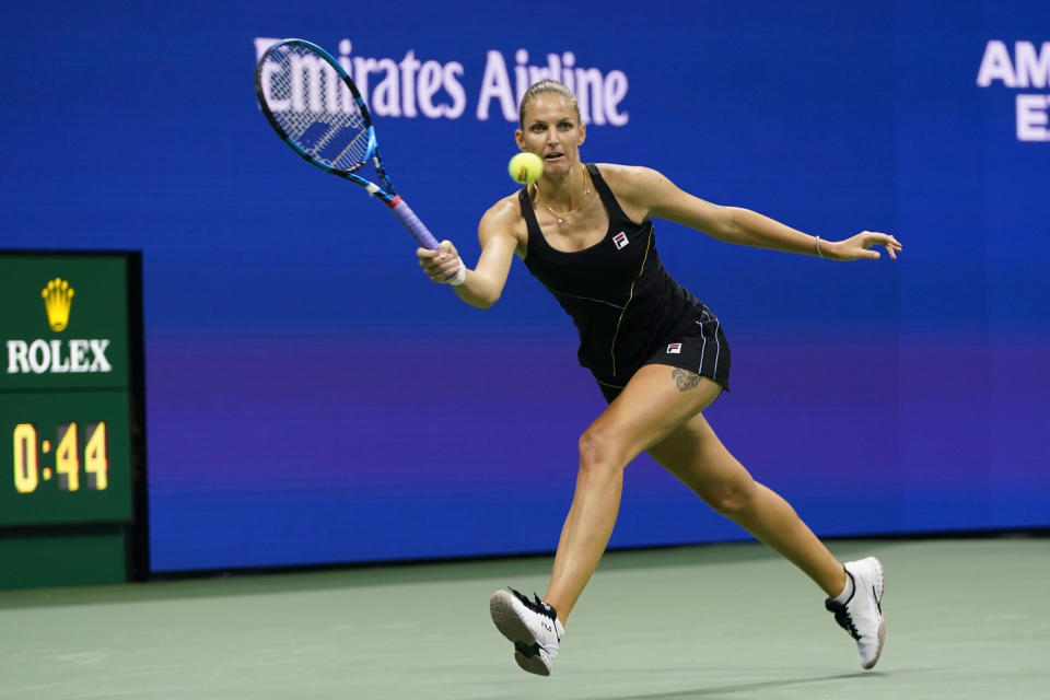 Karolina Pliskova, of the Czech Republic, returns a shot to Amanda Anisimova, of the United States, during the second round of the US Open tennis championships, Thursday, Sept. 2, 2021, in New York. (AP Photo/Frank Franklin II)