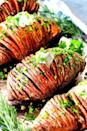 """<p>Hasselback potatoes are great for holiday entertaining because they look impressive but are actually pretty simple to make. A homemade garlic herb butter takes this sweet potato version to the next level.</p><p><strong>Get the recipe at <a href=""""https://carlsbadcravings.com/hasselback-sweet-potatoes-recipe/"""" rel=""""nofollow noopener"""" target=""""_blank"""" data-ylk=""""slk:Carlsbad Cravings"""" class=""""link rapid-noclick-resp"""">Carlsbad Cravings</a>.</strong></p><p><a class=""""link rapid-noclick-resp"""" href=""""https://go.redirectingat.com?id=74968X1596630&url=https%3A%2F%2Fwww.walmart.com%2Fbrowse%2Fhome%2Fflatware%2F4044_623679_639999_2073814&sref=https%3A%2F%2Fwww.thepioneerwoman.com%2Ffood-cooking%2Fmeals-menus%2Fg36876289%2Fsweet-potato-side-dishes%2F"""" rel=""""nofollow noopener"""" target=""""_blank"""" data-ylk=""""slk:SHOP KITCHEN KNIVES"""">SHOP KITCHEN KNIVES</a></p>"""