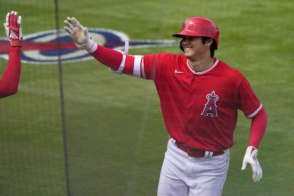 Shohei Ohtani celebrates after hitting a solo home run against the Cincinnati Reds on March 15.