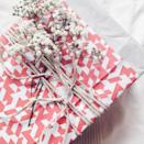 """<p>For a last-minute, but truly special touch, clip some fresh flowers, and tuck them into a web of ribbon, raffia, or twine. </p><p><a class=""""link rapid-noclick-resp"""" href=""""https://www.amazon.com/Whaline-Packing-Festival-Decoration-Weaving/dp/B075G6XF9F?tag=syn-yahoo-20&ascsubtag=%5Bartid%7C10072.g.34015639%5Bsrc%7Cyahoo-us"""" rel=""""nofollow noopener"""" target=""""_blank"""" data-ylk=""""slk:SHOP RAFFIA"""">SHOP RAFFIA</a></p>"""