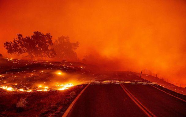 PHOTO: Embers blow across a road during the Kincade fire near Geyserville, Calif., Oct. 24, 2019. (Josh Edelson/AFP via Getty Images)